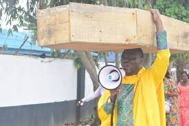 Pastor carries coffin